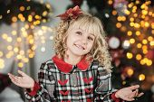 Happy Excited Girl Child Holding Christmas Gift Box. poster