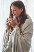 Woman With Cup Of Hot Drink By The Window. Looking At Window And Drink Tea. Good Morning With Tea. A poster