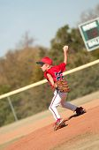 stock photo of little-league  - Young little league baseball player pitching the ball - JPG
