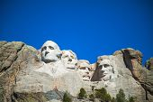 foto of rock carving  - Mount Rushmore monument in South Dakota in the morning - JPG