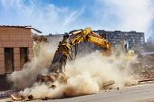 stock photo of bulldozer  - Bulldozer crushing the building at construction site - JPG
