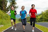 stock photo of leaping  - Active people running - JPG