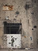 picture of mural  - mural and bullet holes in beirut lebanon - JPG