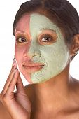 image of black woman spa  - Woman with special facial mask applied on her face - JPG