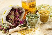 Healing Herbs And Healthy Tea On Wooden Table, Herbal Medicine