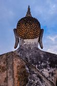 stock photo of budha  - Detail of head of stone statue of sitting Buddha in Sukhothai historical park Thailand - JPG
