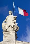 picture of gare  - Statue and French flag above the main entrance of Gare du Nord Station in Paris - JPG