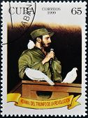 CUBA - CIRCA 1999: A stamp shows Fidel Castro in Havana entrance with a dove percheder