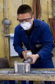 Polishing Metal In Workshop poster