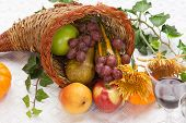 stock photo of horn plenty  - Horn of plenty full of fresh fruits  - JPG