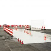 stock photo of driving school  - Test drive track for wet conditions education - JPG
