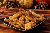 stock photo of pretzels  - A snack mix of rice cereal pretzels nuts and cheeses sticks - JPG