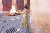 FES, MAROCCO - October 15 2013 : Girl watching the fire on Eid al-Adha. The festival is celebrated b