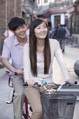 image of tandem bicycle  - Young couple on tandem bicycle in Beijing - JPG