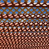 foto of pergola  - Close up shot of pergola roof against blue sky - JPG
