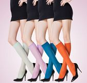 stock photo of short legs  - collection of colorful short stockings on sexy woman legs - JPG