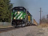 stock photo of bnsf  - a southbound work train picks up speed after being stopped for awhile - JPG