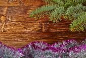 Christmas Decoration. Fir-tree, Tinsel And Wooden Background. Selective Focus