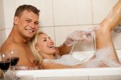 image of bubble bath  - male giving Royal bath to his wife - JPG