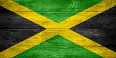 stock photo of jamaican  - flag of Jamaica or Jamaican banner on wooden background - JPG