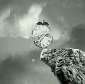 image of surrealism  - Metaphysics imagine representing an old and broken clock that falls off a cliff in a dramatic and surreal background - JPG