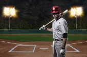 picture of ball cap  - Baseball Player on a red uniform on a baseball Stadium - JPG