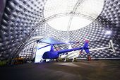 MOSCOW, RUSSIA - DEC 21, 2013: Helicopters in hangar of Heliport Moscow - unique project to create E