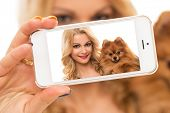 Selfie. Cute woman with dog