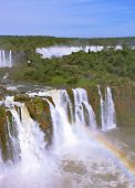 The magnificent rainbow costs over roaring water streams. The best-known falls in the world - Iguazu