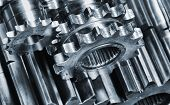 stock photo of titanium  - aerospace titanium and steel gears and cogs - JPG