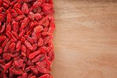 goji berries on wooden background