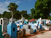 image of deceased  - typical colourful mexican cemetery of small city - JPG