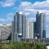 stock photo of highrises  - New highrise condominium and apartment buildings sky clouds - JPG