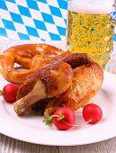 stock photo of pretzels  - Oktoberfest chicken and pretzel beer radish close up  - JPG