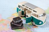 picture of camper-van  - Vacation camper van with a stack of suitcases on a map - JPG