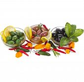 Border row of olives dish with vegetables, herbs, spices isolated on a white background