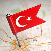 Turkey Small Flag on a Map Background. poster