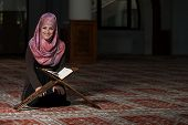 picture of tasbih  - Muslim Woman Reading Holy Islamic Book Koran - JPG