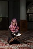 pic of tasbih  - Muslim Woman Reading Holy Islamic Book Koran - JPG