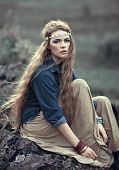 stock photo of hippy  - Beautiful hippie girl sitting on stone - JPG