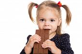 picture of charming  - Charming little girl eating chocolate - JPG