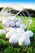 stock photo of golf bag  - Golf game. Golf balls in the grass. ** Note: Shallow depth of field - JPG