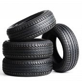 picture of four-wheel drive  - four black tires isolated on white background - JPG
