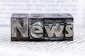stock photo of newspaper  - the word news written with lead letters - JPG