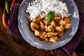 stock photo of curry chicken  - overhead view of indian chicken curry on plate - JPG