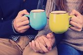 stock photo of hot couple  - Young couple drinking tea - JPG
