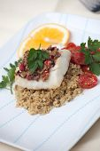 pic of halibut  - Baked halibut with olive tapenade crust garnished with couscous fried cherry tomatoes and fresh parsley - JPG
