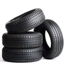 picture of four-wheel  - four black tires isolated on white background - JPG