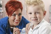 stock photo of flu shot  - Small boy watching as nurse gives him a shot - JPG
