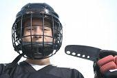 pic of sticks  - A Portrait of hockey ball player with hockey stick - JPG